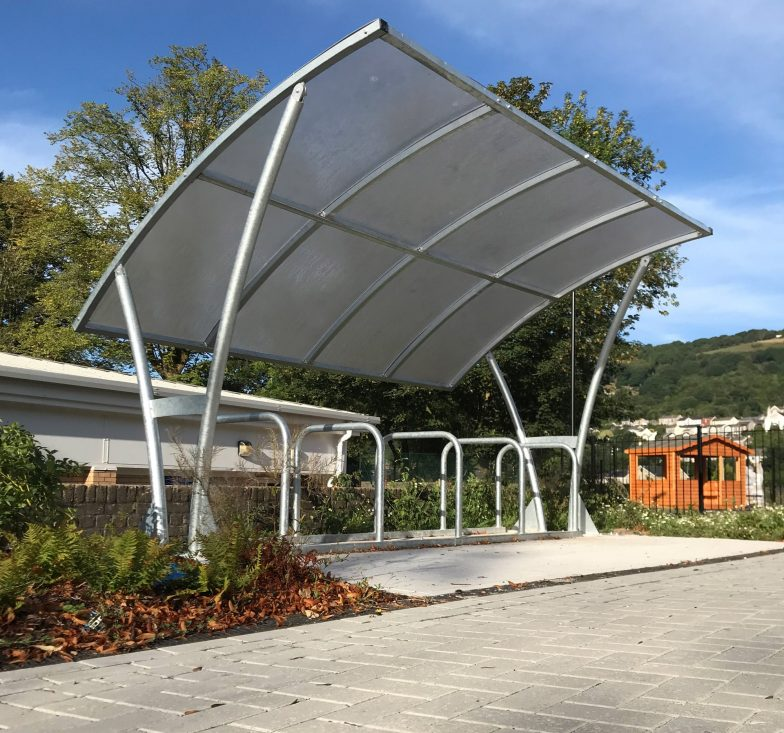 cycle shelter with large tilted canopy roof