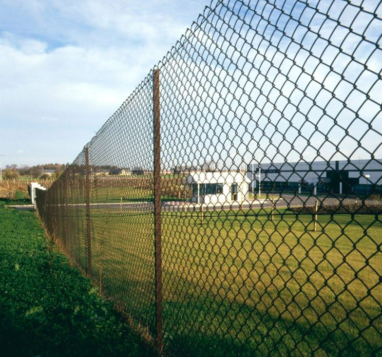 Chain link fence on tennis court