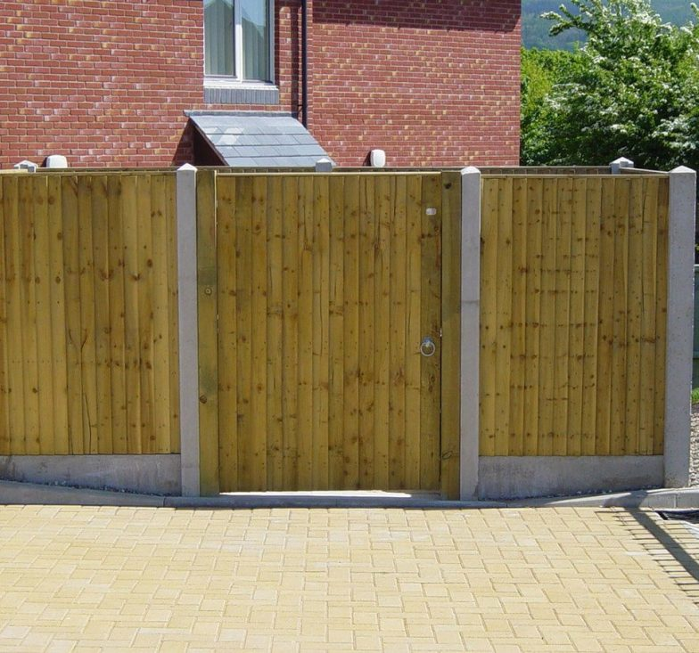 Close-board fence with concrete posts